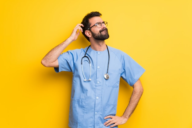 Surgeon doctor man having doubts while scratching head Premium Photo