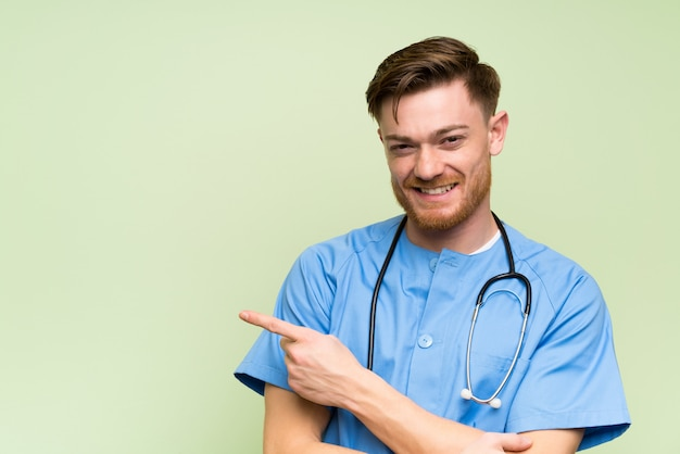 Surgeon doctor man pointing finger to the side Premium Photo