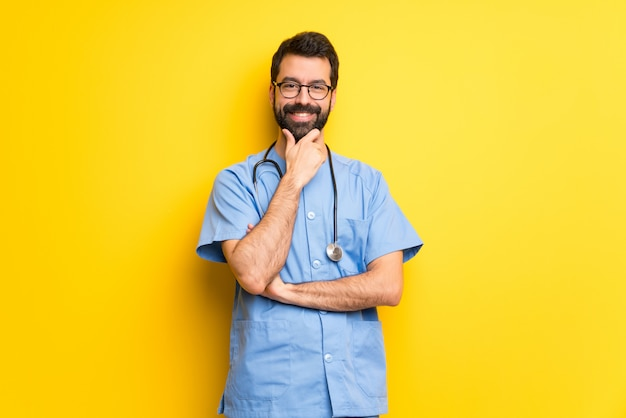 Surgeon doctor man with glasses and smiling Premium Photo