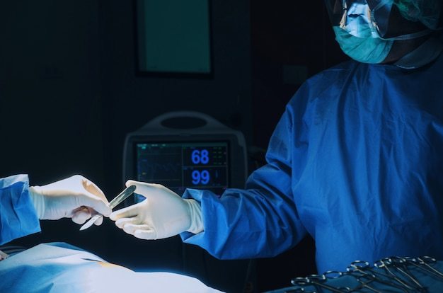 Surgeon sending surgical instrument to hand to rescue