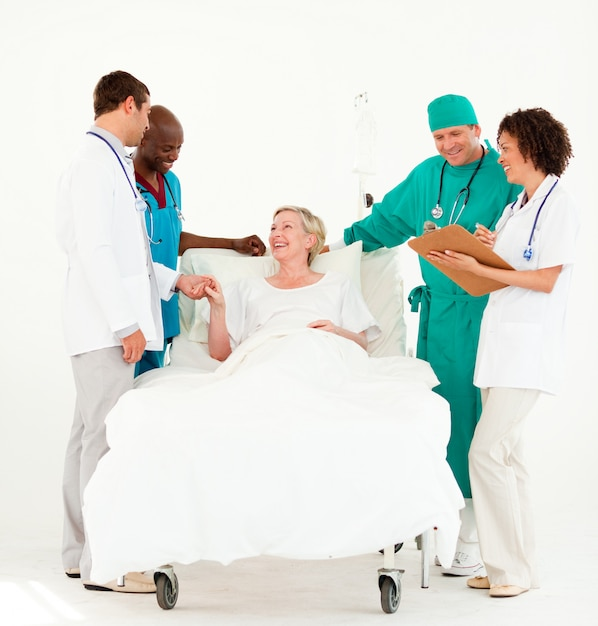 Surgeon with doctors looking after a senior patient Premium Photo