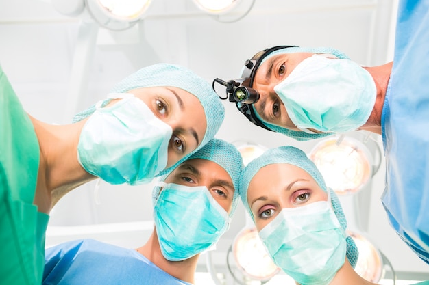 Surgeons operating patient in operation theater Premium Photo