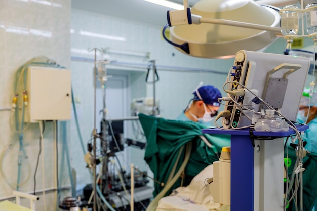 Surgery doctor in surgery for interventions with surgery tools in surgeon operation for open heart Premium Photo