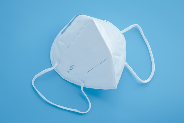 Surgical kn95 respirator, white protective medical face mask to cover the mouth and nose. Premium Photo