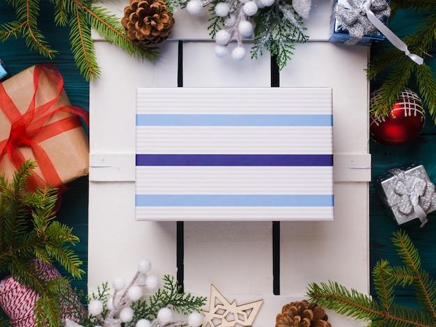 Surprise christmas gift flat lay concept Premium Photo