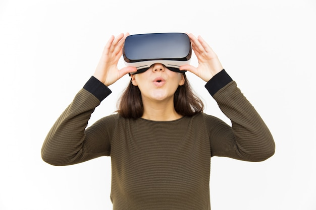 Surprised excited gamer in vr headset Free Photo