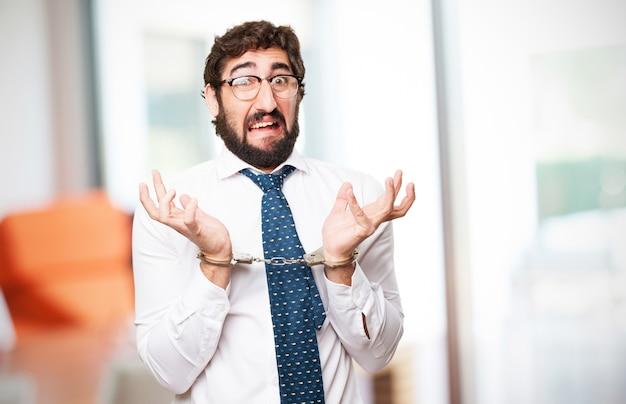 Surprised man handcuffed Free Photo