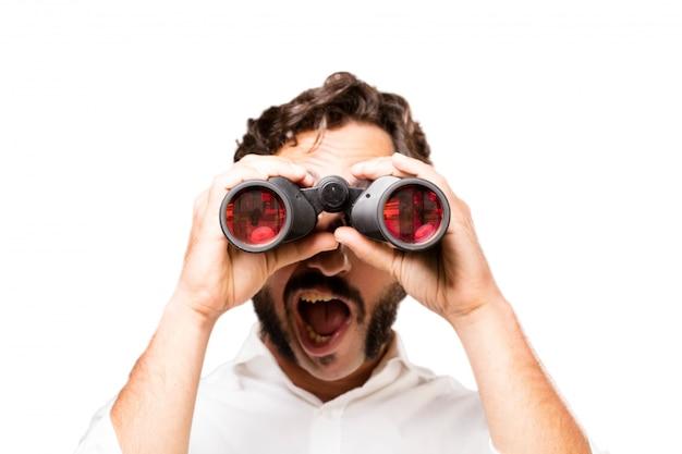 Surprised man with binoculars Free Photo