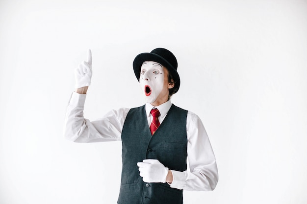 Surprised mime holds his finger up Free Photo