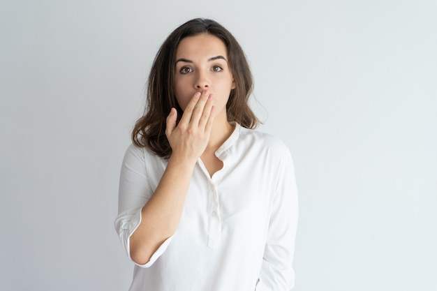 Surprised and shocked girl learning news or gossip. Free Photo