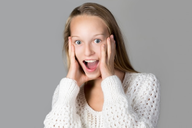 Surprised teen with open mouth Free Photo