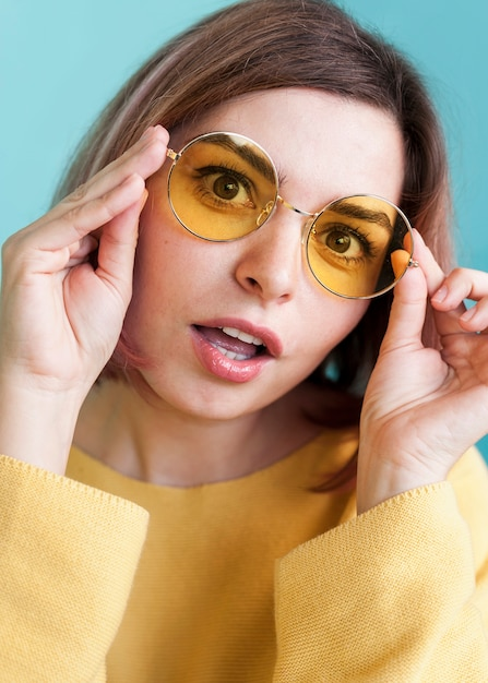 Surprised woman holding glasses close up Free Photo