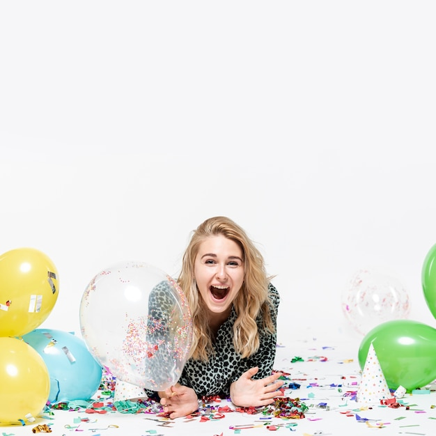 Surprised woman holding a transparent balloon Free Photo