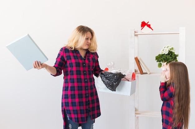 Surprised woman holds box with plastic trash Premium Photo