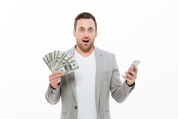 Surprised young handsome businessman Free Photo