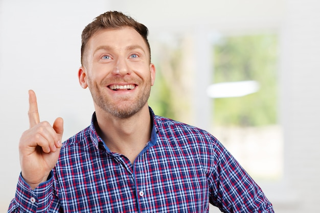 Surprised young happy man just came up with idea Premium Photo