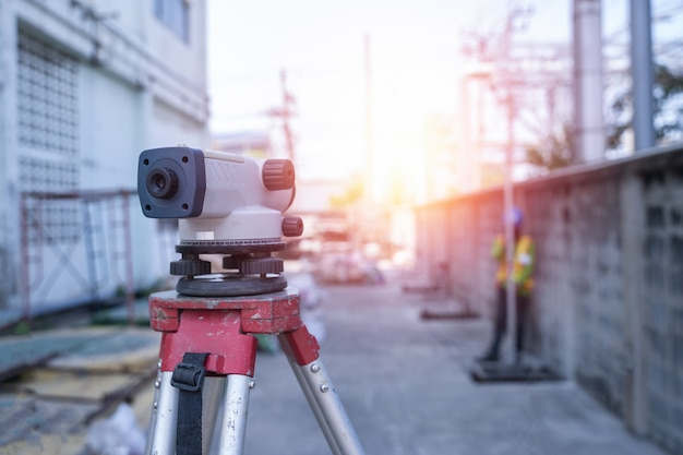 Survey automatic levels equipment at construction site outdoor during surveying work Premium Photo