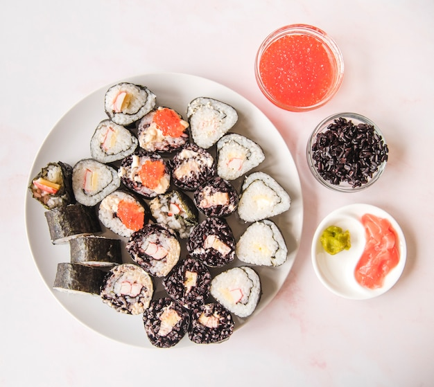 Sushi assortments with spices top view Free Photo