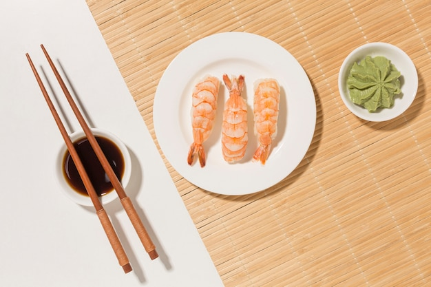 Sushi day concept with wasabi and chopsticks Free Photo
