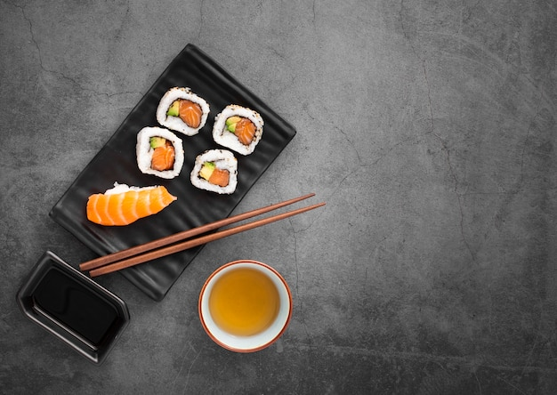 Sushi mix with chopsticks with copy space Free Photo