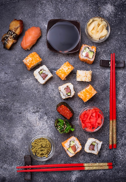 Sushi and roll set on black table Premium Photo