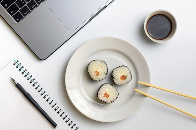 Sushi rolls snacking at work. break time for sushi eating. Premium Photo