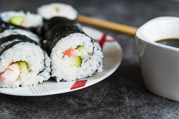 Sushi rolls, soy sauce and chopsticks Free Photo