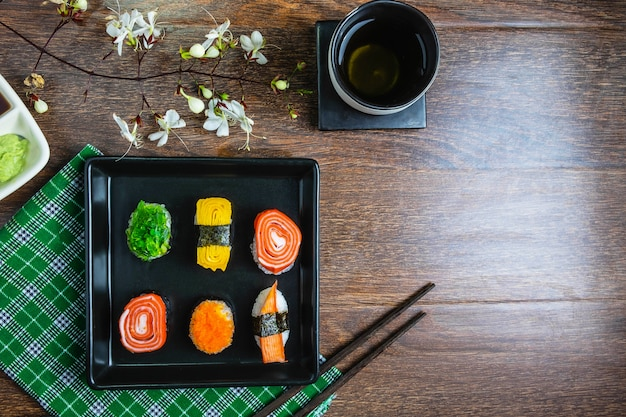 Sushi rolls on the table Premium Photo