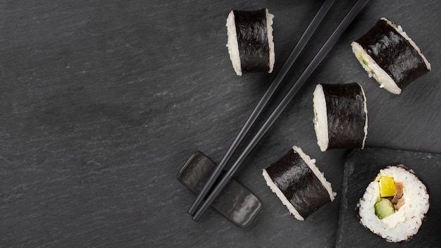 Sushi rolls with chopsticks and copy space Free Photo