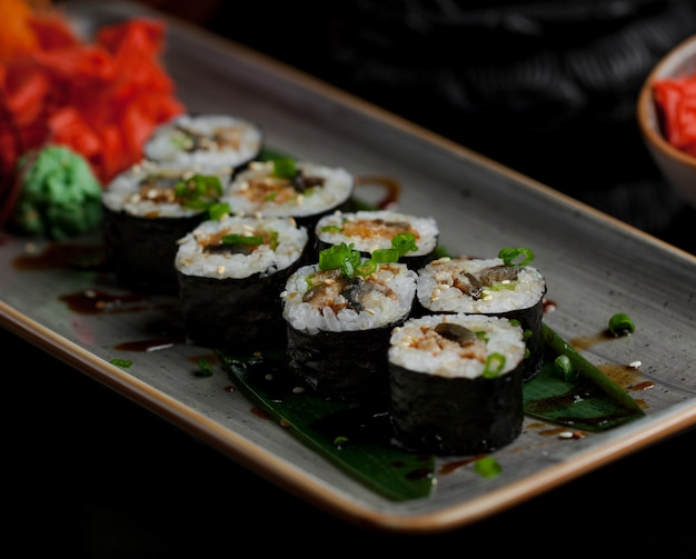 Sushi rols with variety of foods inside Free Photo