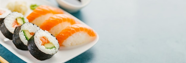 Sushi served on plate on blue table Free Photo