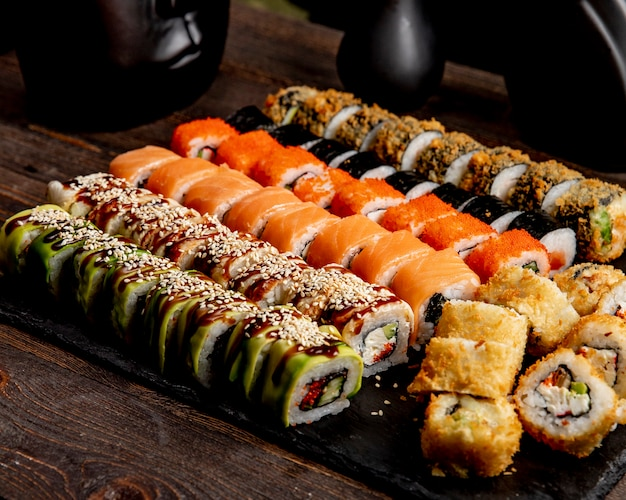 Sushi set hot rolls avocado california and salmon rolls Free Photo