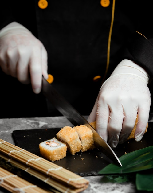 Sushi set with gold color on the table Free Photo