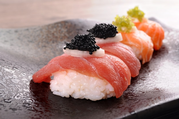 Sushi with rice, salmon and caviar Free Photo