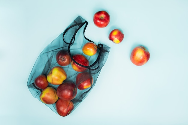 Sustainable eco packaging concept: shopping for groceries with a multi-use bag to reduce ecological footprint Premium Photo