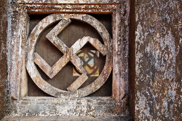 Swastica. stone window of the sacred temple Premium Photo