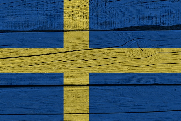 Sweden flag painted on old wood plank Premium Photo