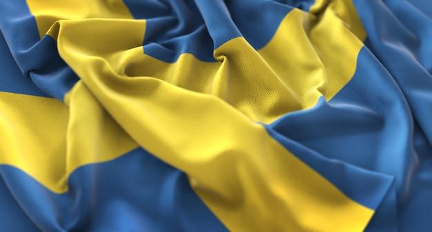 Sweden flag ruffled beautifully waving macro close-up shot Free Photo
