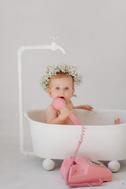 Sweet baby girl in bathroom Free Photo