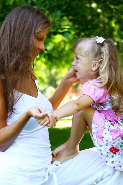 Sweet and beautiful girl with mom Free Photo