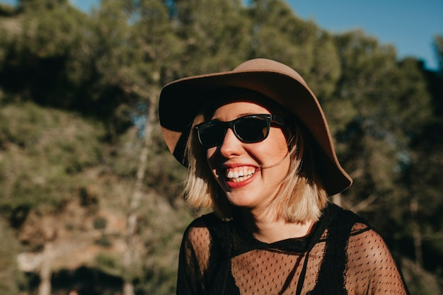 Sweet Blonde Woman With Sunglasses And Hat Laughing In Nature At Sunset Close Up Potrait