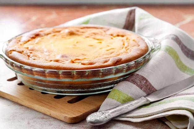 Sweet cottage cheese casserole in glass baking dish Premium Photo