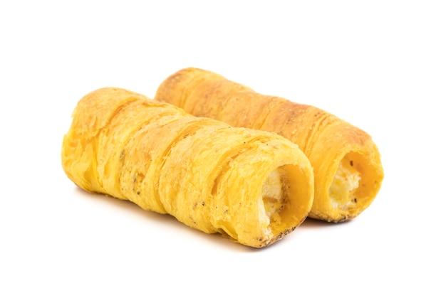 Sweet cream roll bakery food on white background Premium Photo