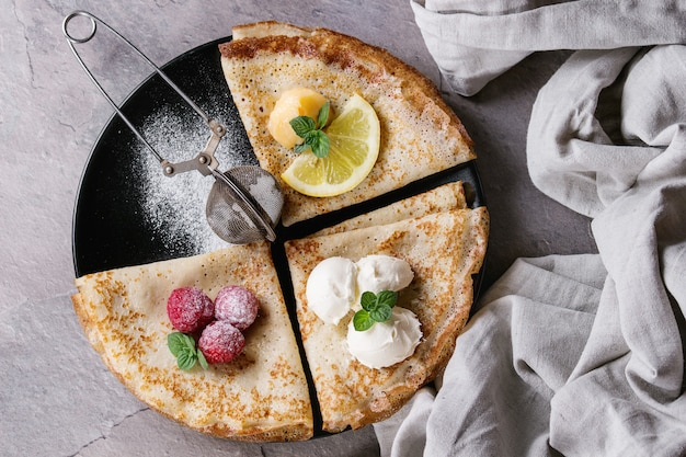 Sweet crepes pancakes with different fillings Premium Photo