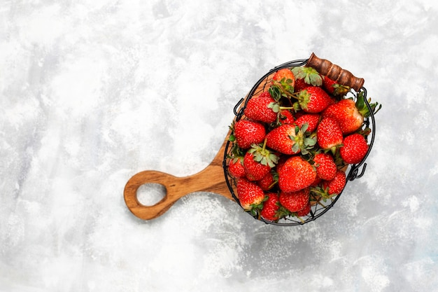 Sweet delicious strawberries in basket,top view Free Photo