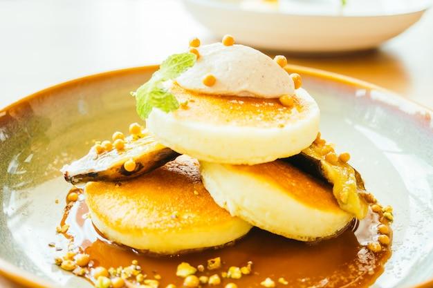 Sweet dessert pancake with banana and sweet sauce Free Photo