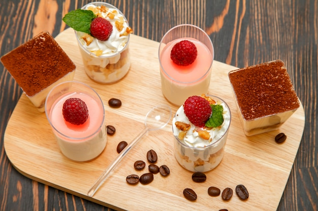 Sweet desserts on a wooden stand Premium Photo
