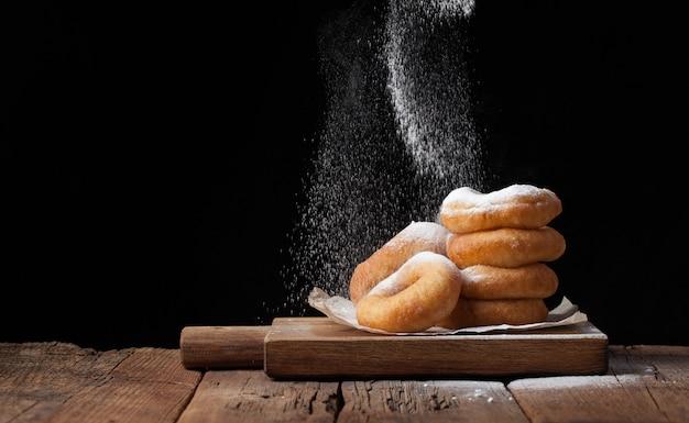 Sweet donuts with powdered sugar. Premium Photo