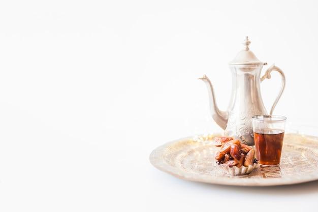 Sweet dry dates and tea Free Photo