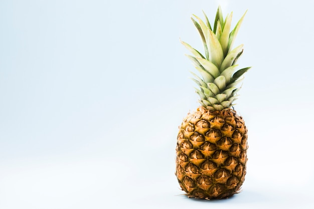 Sweet exotic pineapple on light background Free Photo